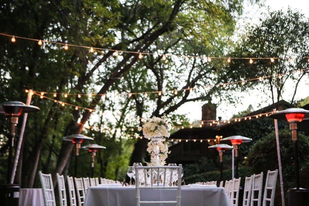 outdoor wedding with the table setting and linens by la tavola